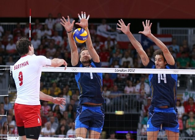 Olympics: Day Two - JULY 29: Michal Lasko #7 and Alessandro Fei #14 of Italy try to stop a shot by Zbigniew Bartman #9 of Poland during Men's Volleyball on Day 2 of the London 2012 Olympic Games at Earls Court on July 29, 2012 in London, England. (Photo by Elsa/Getty Images)