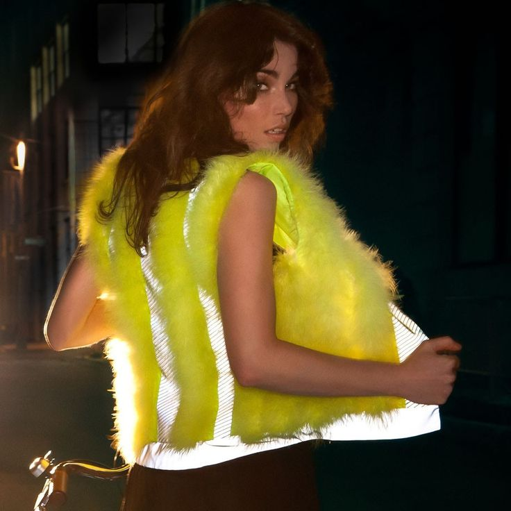 Vespertine Road Hog Reflective Waistcoat (Eco Citron): simply the most eye-popping piece of cycling clothing you'll ever see.  Bar none.  Vespertine's Road Hog is softer than a cloud but keeps you deliciously warm.  Claim your right to the road fabulously in this exquisitely tailored, fully lined bodice of water-resistant eco-circle recycled/recyclable polyester, generously adorned all over with fluo citron Meribou feathers. And you don't see many of those on the roads these days. £270