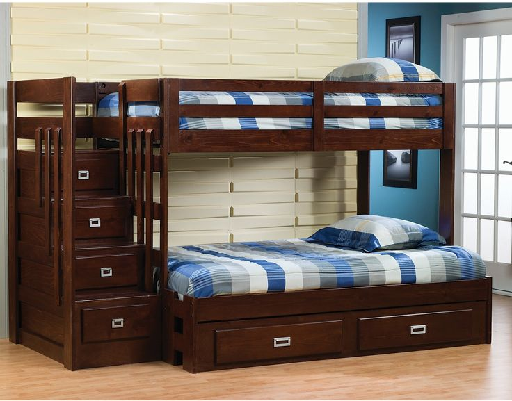 The Berkeley Twin/Full Staircase Bunk Bed is the ideal choice for your children's bedroom.  Constructed from solid pine and pine veneers, this bunk bed is very durable and will last for years and years!  The warm merlot finish is contemporary and will match many existing room furnishings. With additional storage space in the convenient staircase, this unit saves valuable bedroom space!  Add the optional trundle for more storage convenience!