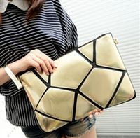 Modern cutout envelope clutch in gold from lovemisseve.com