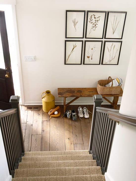 Minimalist accessories, with a hint of vintage charm, are all this entry in a country farmhouse needs to welcome family and friends.