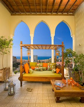 The Indonesian teak daybed and coffee table is perfect in this Moroccan setting.