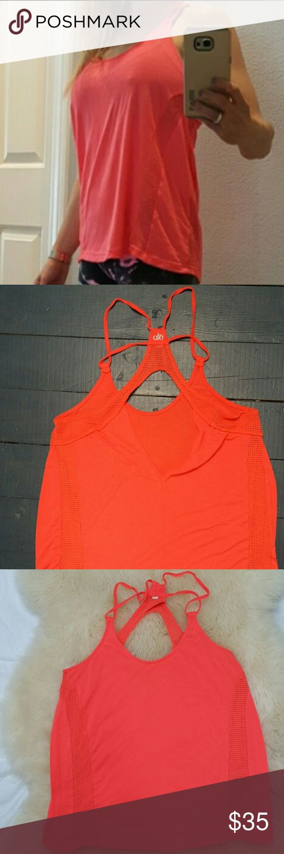 ALO Yoga💕Mesh Flowy Tank Orange Flowy Yoga Top M VGUC size medium flowy tank by ALO yoga with mesh detailing to keep you cool. Gorgeous fluorescent orange color. Strappy design. 🚫trades // ✅bundle discounts available✅ #50111 ALO Yoga Tops Tank Tops