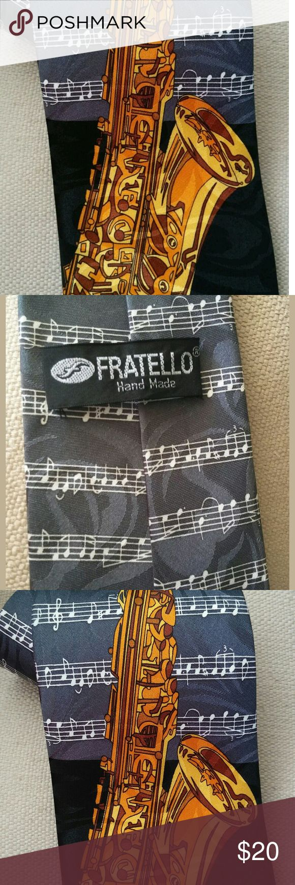 Beautiful Saxophone Musical Tie Beautiful tie in good condition. Tie has no issues. Please note the tag with fabric type is missing. Small spot included in picture. Fratello Accessories Ties