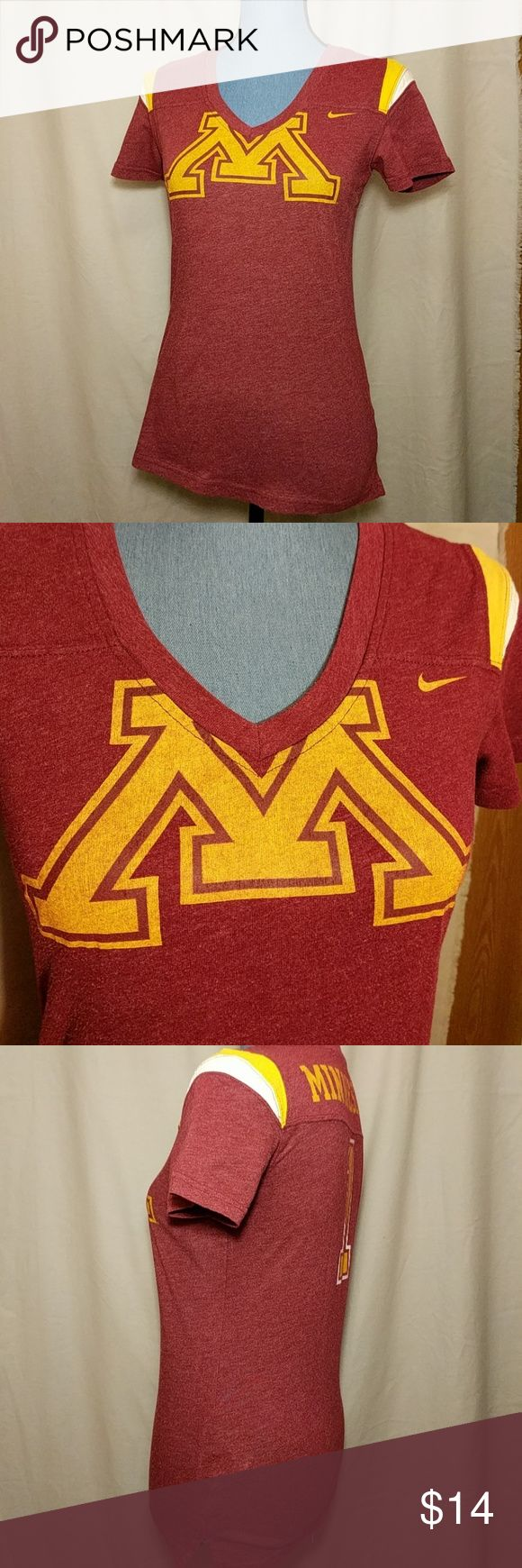 Nike Women's Minnesota Gophers Tee University of Minnesota college team, Minnesota Gophers. Women's size Medium, V-neck short sleeve tee. Colors are maroon and gold. Approximate flat lay measurements include: armpit to armpit is 16.5 inches, shoulder to sleeve is 7 inches, shoulder to bottom of hem is 24 inches. Nike Tops Tees - Short Sleeve