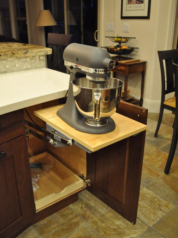 Rather than leaving your standing mixer on your countertop, install a hidden shelf under the counter and store your mixer there. Leaving it in one easily accessible place makes baking easier and frees up counter space.