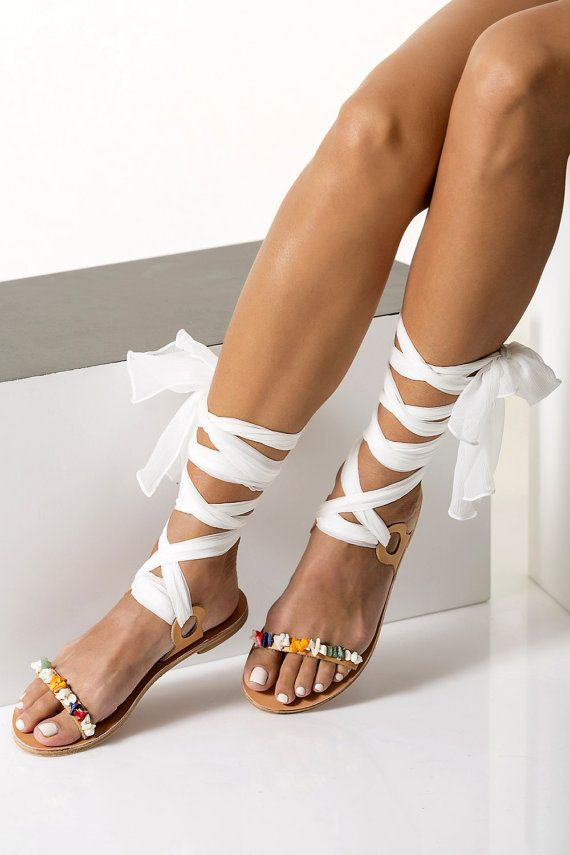 Luxurious sandals handmade of fine quality leather with ankle wraparound  silk laces and hand-sewn mother of pearls beads. They will work perfectly  for all ...
