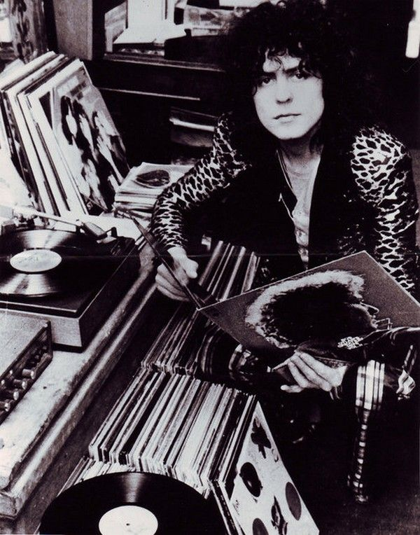Marc Bolan on his super-duper leopard tuxedo, looking cool as usual.