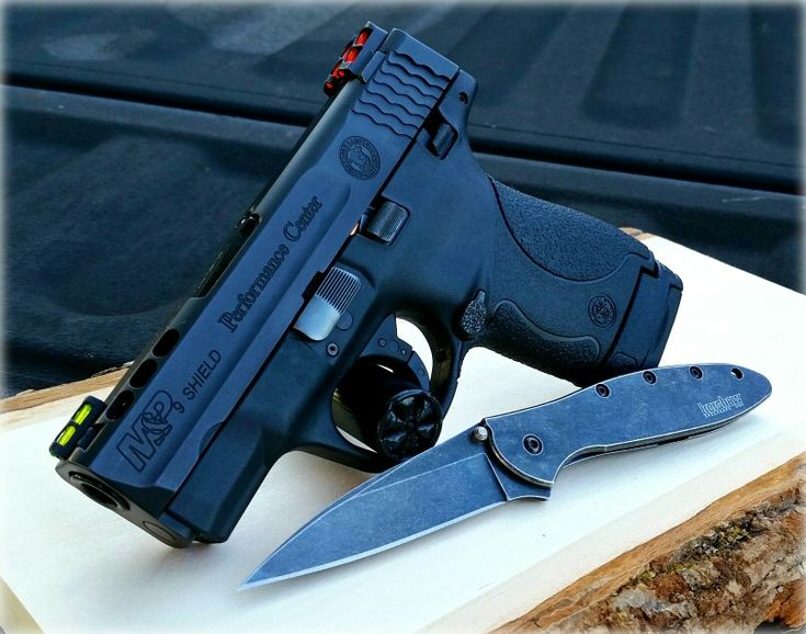 Smith and Wesson Performance Center M&P Shield 9mm and Kershaw Leek Speedsafe Flipper.