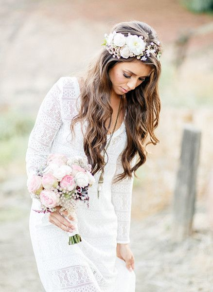 Floral Compliments, I, Michele, can create this look for you. The flowers I create are made of ribbon or fabric from your wedding dress/shawl.  Latest customer used an applique...shh...the rest is a secret until after 6/27/14.  But check out my site: floralcompliments.com