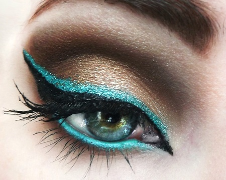 Brown smokey eye with teal eyeliner