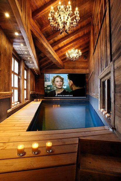 1) It's a Home theater with indoor pool and 2) what gorgeous wood ceilings, walls, floors...  beautiful!