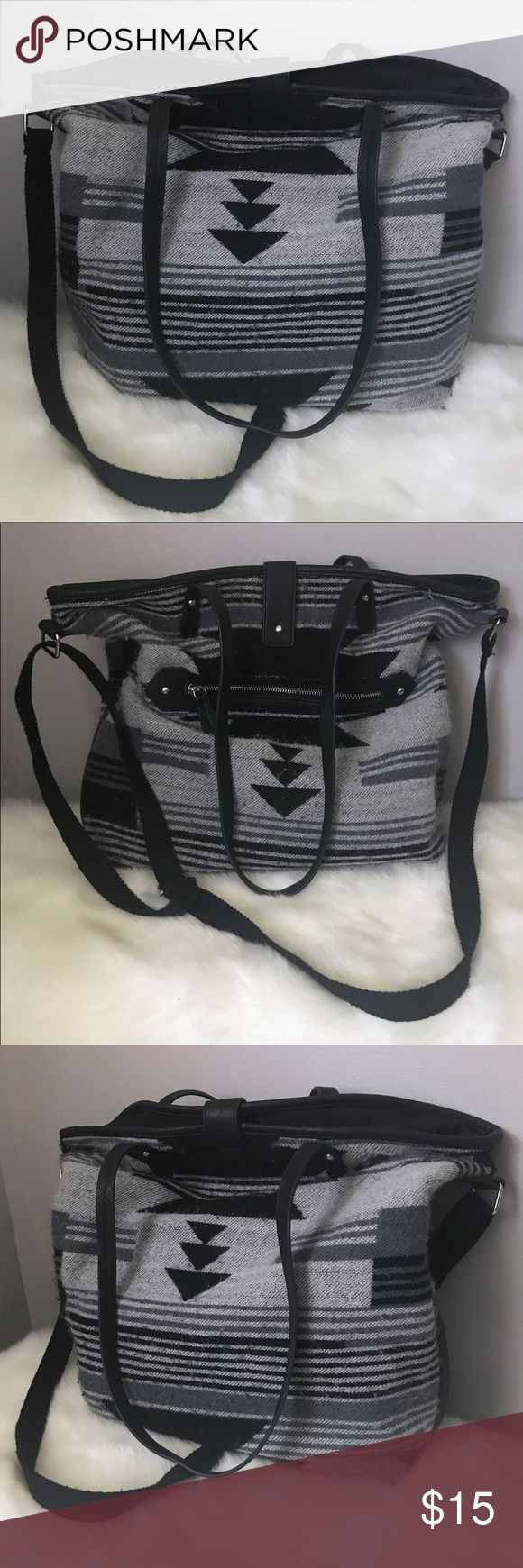 American Eagle Grey & Black Tote Bag American Eagle Grey & Black Tote Bag. Used but in great condition. Has fuzzy outside. Nice & big for schoolbooks and what not. American Eagle Outfitters Bags Totes