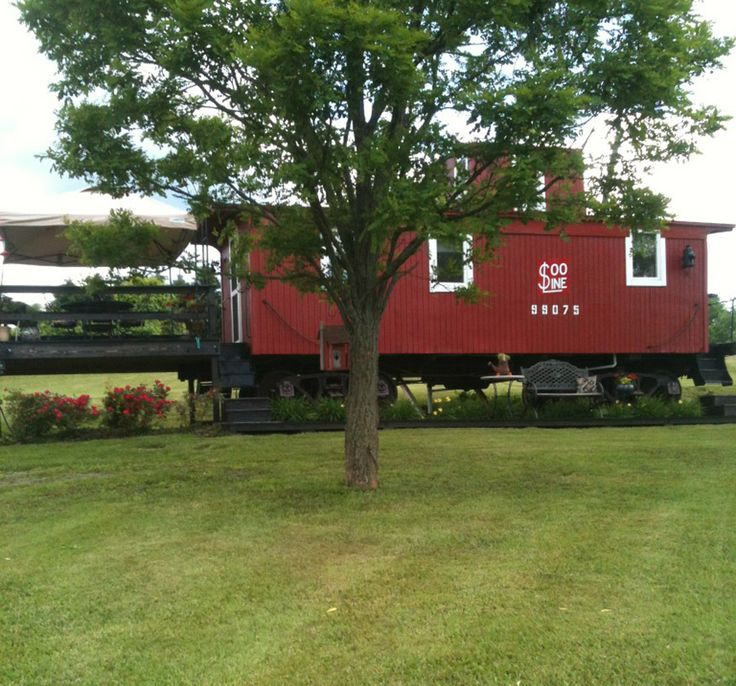 caboose house. I always imagined living in a caboose that would roll along behind trains all over this country when I was a farm child waving to the passing trains