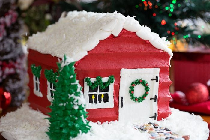 Show-stopping holiday cake... this SANTA HOUSE CAKE is easier than you would think and seriously delicious! My video shows step by step how to make it!