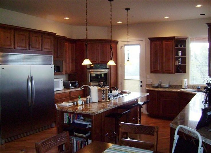 Stainless steel appliances granite counter tops center for Kitchen center island cabinets