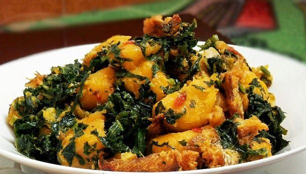 The Yam Porridge can also be referred to as yam soup. It is mainly yam cooked with ingredients and the resulting dish contains some soupy liquid.  Ingredients *.1 kg (2.2 lbs) white yam *.Red palm Oil (to colour) *.1 smoked fish (titus/mackerel) OR dry fish *.1 tablespoon ground crayfish *.1 medium onion *.Fresh green vegetable (eg pumpkin, parsley, scent