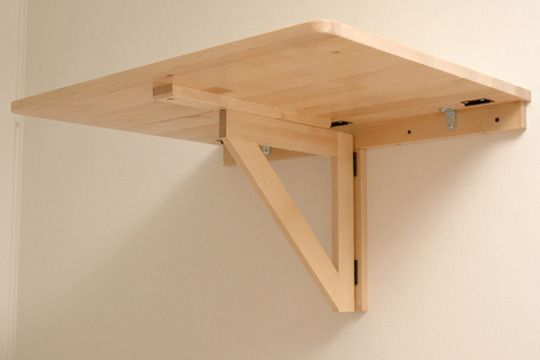 IKEA's wall-mounted drop leaf folding table, stealing the design for using with the window sills.