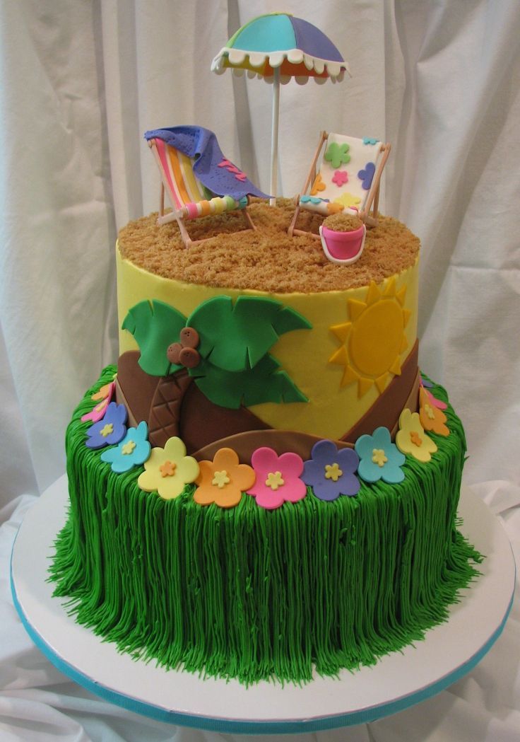 "Luau - This cake was done for a little girls backyard Luau themed birthday party. The cake is done in buttercream with fondant accents. The ""grass skirt"" was piped with buttercream with fondant flower accents. The beach umbrella, chairs and sand pail were done in gumpaste. The ""sand"" is brown sugar."
