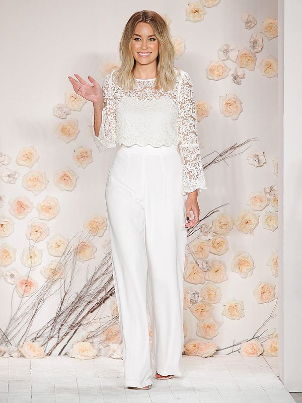 Lauren Conrad in a white jumpsuit and lace top at her fashion show at NYFW