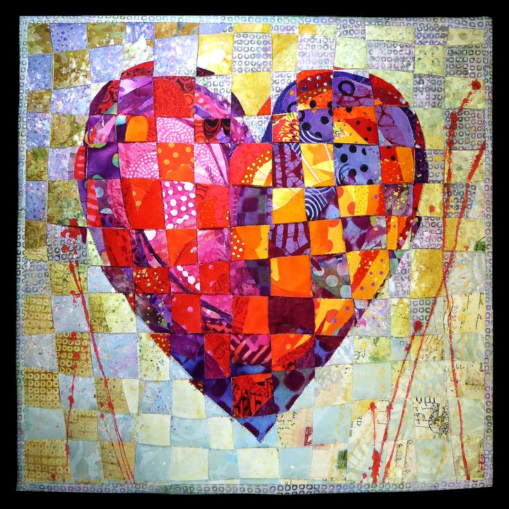 Two Hearts Beating as One two mini heart quilt tops, sliced them and wove them into one quilt. By Nancy Messier