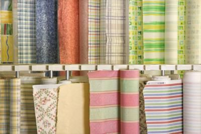 Give a plain glass plate, vase or bowl a new look by decoupaging fabric onto it. Mod Podge, a type of decoupage glue sold in craft stores, goes on white but dries clear, allowing you to glue objects ...