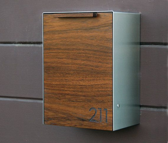 This stainless steel and teak mailbox measures 9W x 12 1/4H x 6D and can also be stained to match your existing woodwork. The mailbox is designed after