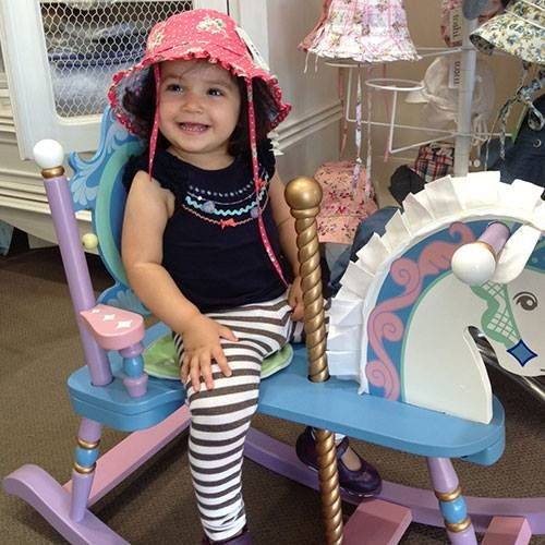 Cute Valani having fun on the Levels of Discovery - Kiddie Ups Carousel Rocking Horse