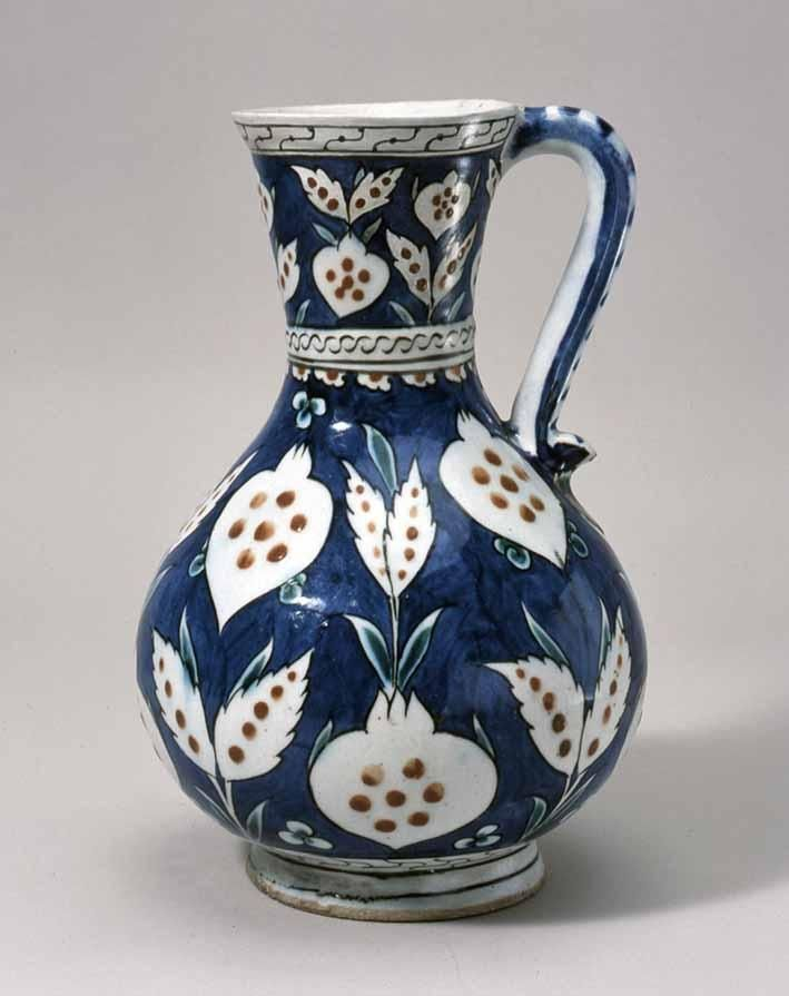 Bottle with handle and design of flowers (Iznik ware), polychrome Glazed Pottery, Turkey, second half of 16th century, height 25.2cm.