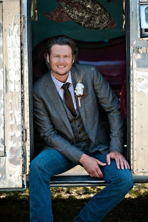 Blake shelton at his and Miranda's wedding in the junk gypsy airstream we created for Miranda.