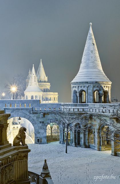 Fisherman's Bastion - Budapest, Hungary - Amazing photograph from the castle in the old town of Buda covered in snow. I have been to Buda, but never when is under snow, so, this year it is a must to visit again. If you are planing to visit the Hungary's capitol in the winter, have in mind that Buda is on hill and the wind is no stranger there, so that means that is freezing cold, make sure that you wear warm winter clothes. Pest is not as windy as Buda because it's located on a flat terrain.