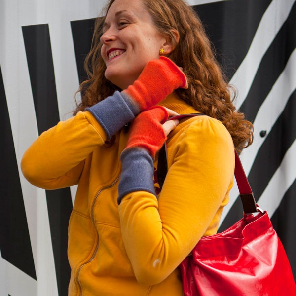orange cashmere wristwarmers and medium red leather handbag