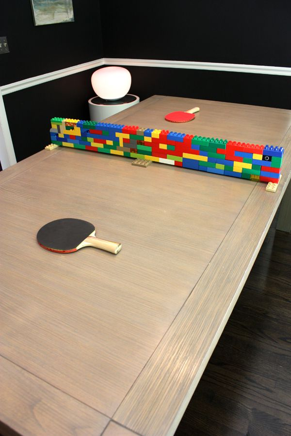 Lego divider converts a normal dining table into a ping pong zone