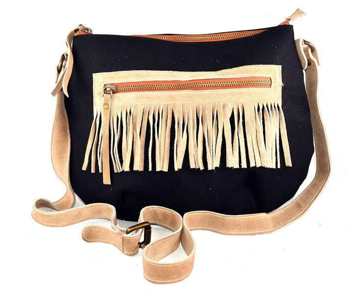 Women Tote bag leather belt and stylish zip. Black colorizing leather camel strips decorative design, removable shoulder strap with internal pockets. Single Unique collection out of all other bags.
