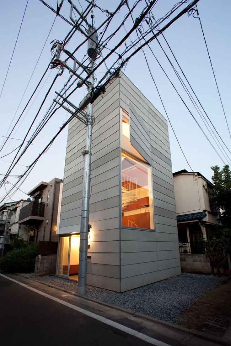 11 Small Modern House Designs From Around The World | This tiny narrow house is spacious enough on the inside to comfortably fit a family of three.