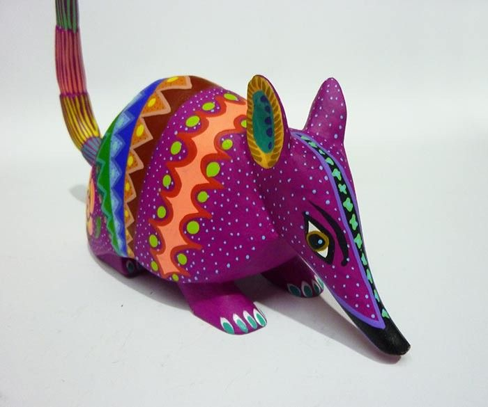 Décor: A few traditional Alebrije (a traditional Oaxaca craft) wood carvings for the tables, such as this armadillo from Mexican artisans, sold at Naay Art for $49.00.