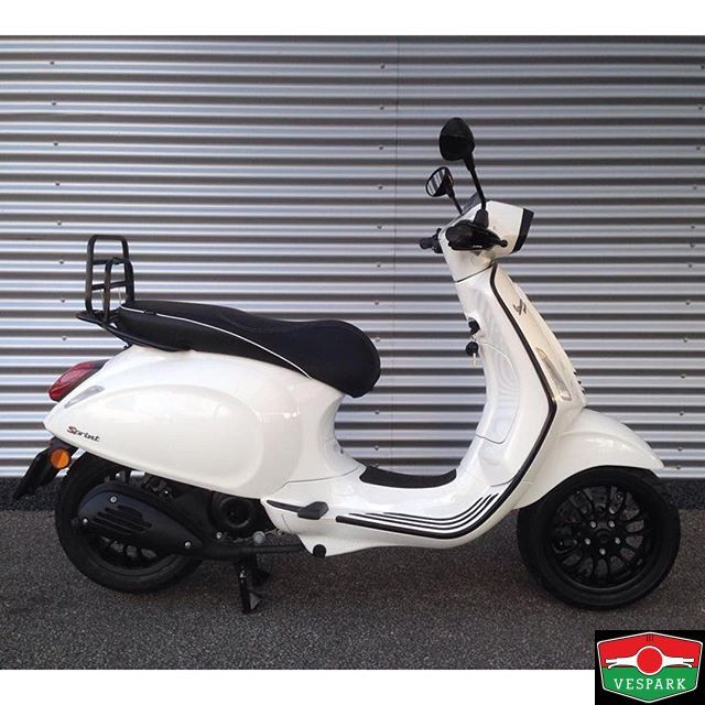 Featuring A very neat Vespa Sprint White with black styling by @collections2wielers