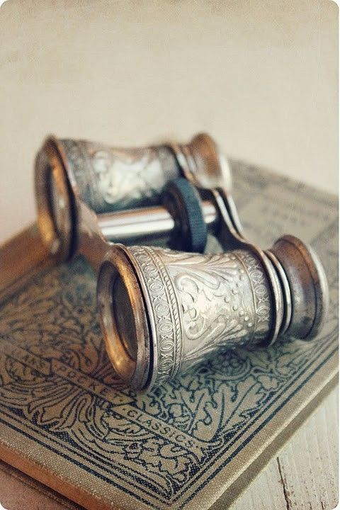 opera glasses and old book