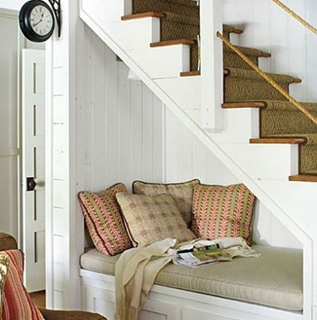 Great little reading nook or shoe-putting-on bench under the steps