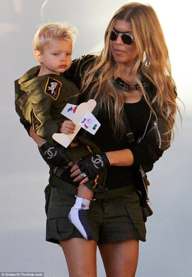 Quite the handful:Fergie carried  son Axl   in Brentwood on Saturday, where she and her h...