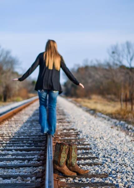 Senior pose railroad tracks