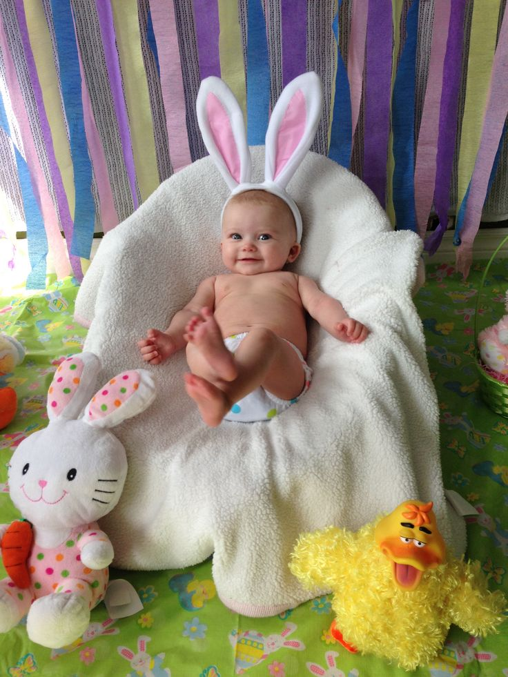 Mini Easter photo shoot for 4 month old. Dollarama streamers for backdrop, Dollarama tablecloth for floor, bunny ears and cheap toys! All less than $10 but with a beautiful baby whose priceless! #easter #photography #baby