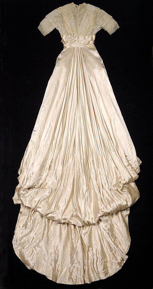 Wedding dress Mrs. Dunstan (American)  Date: 1909–11 Culture: American Medium: Silk, linen, pearl beads, wax. Back