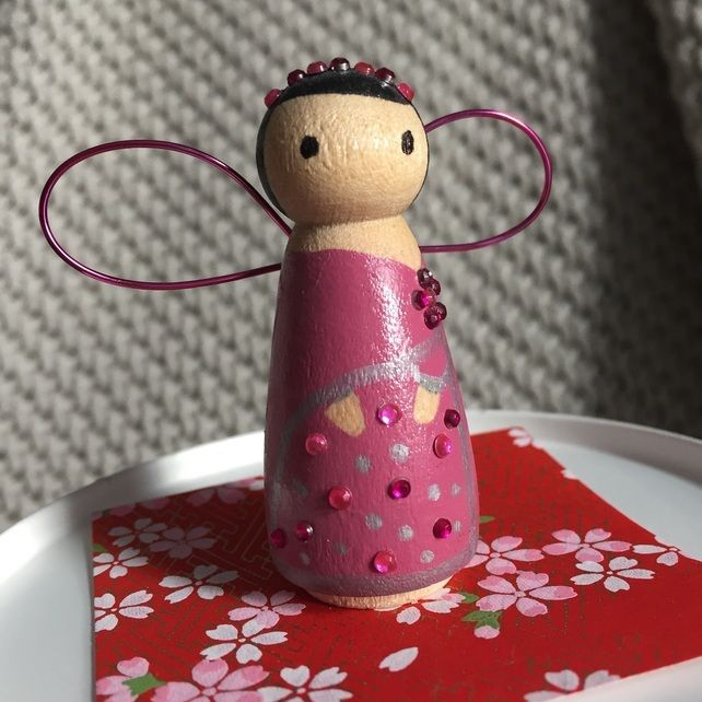 Purple wooden peg fairy with wings and sparkles