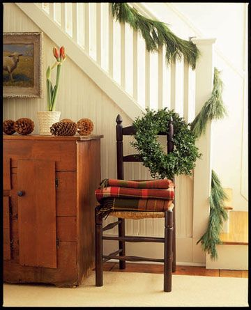 Woodsy Staircase - A simple pine garland adds a touch of life to a banister. Read more: Christmas Garlands - Decorating with Holiday Garlands - Country Living