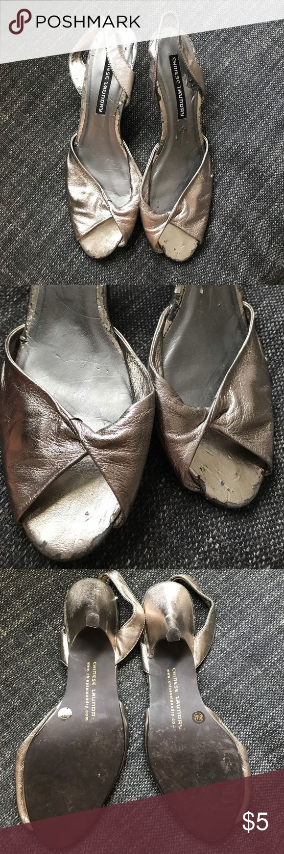 Silver peep toe kitten heels A nice basic peep toe kitten heel shoe.  The foil is coming off the insole of the shoe but the leather is still in tact.  The sole of the shoe is in good condition.  These is some scuff marks.  Still has a lot of life left in them. Chinese Laundry Shoes Heels