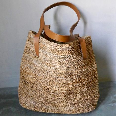 Big sturdy handwoven shopper bag made from banana fiber with genuine quality leather straps, perfect for vegetable shopping or a day at the beach.
