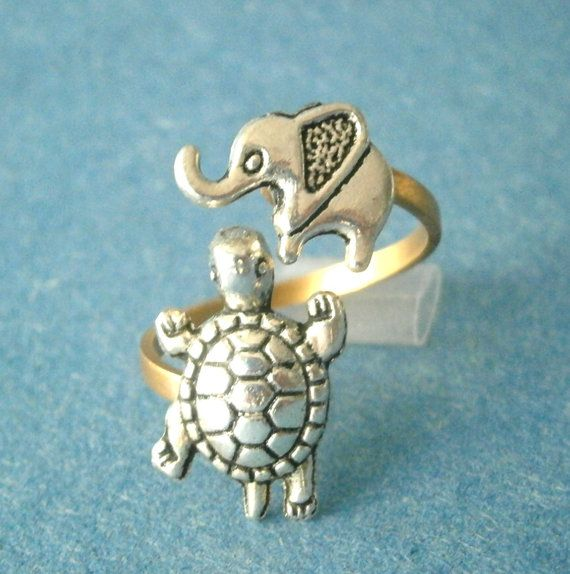 Silver turtle ring with an elephant. $19.00, via Etsy.
