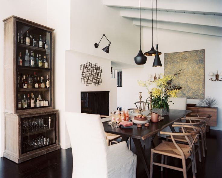 Enlarge a small space by experimenting with a large lighting fixture