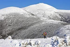 Climbing Mt. Washington, New England's Highest Mountain: Climber Joe Lentini hikes on the Crawford Path below the snowy summit of Mount Washington in northern New Hampshire.